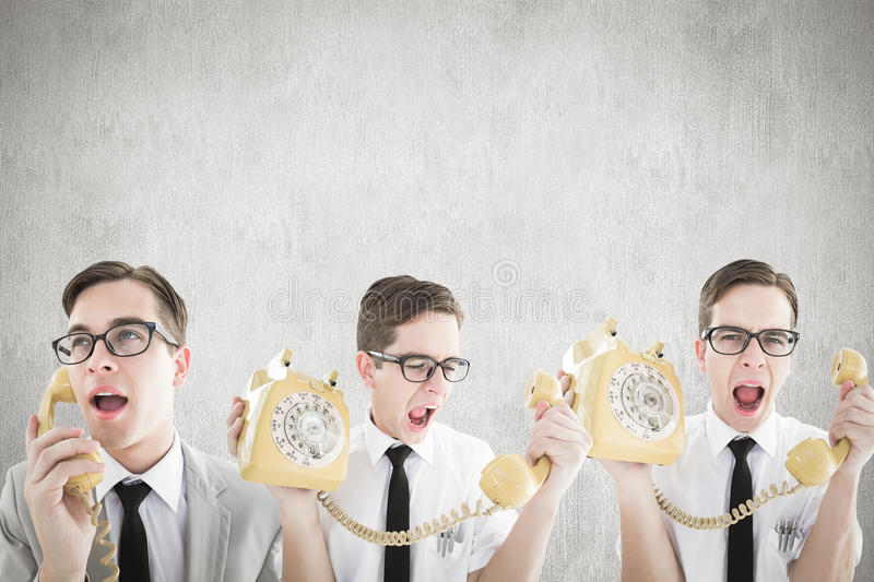 Composite image of nerdy businessman with phone. Nerdy businessman with phone against white and grey background royalty free stock photos