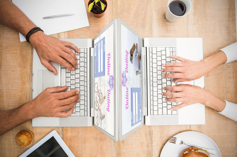 Composite image of online dating app. Online dating app against casual business colleagues working with blank screen laptop royalty free stock images