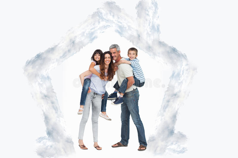 Composite image of parents holding their children on backs stock photo
