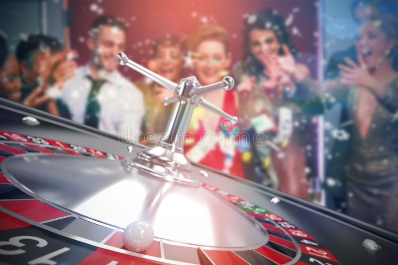 Composite image of people throwing chips and cash on 3d roulette table royalty free stock photography
