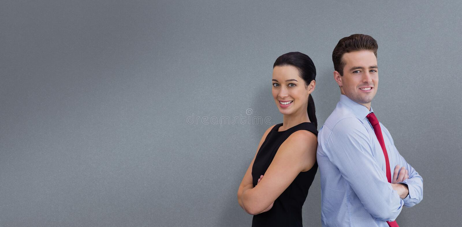 Composite image of portrait of business man and business woman posing back against back. Portrait of business men and business women posing back against back royalty free stock photo