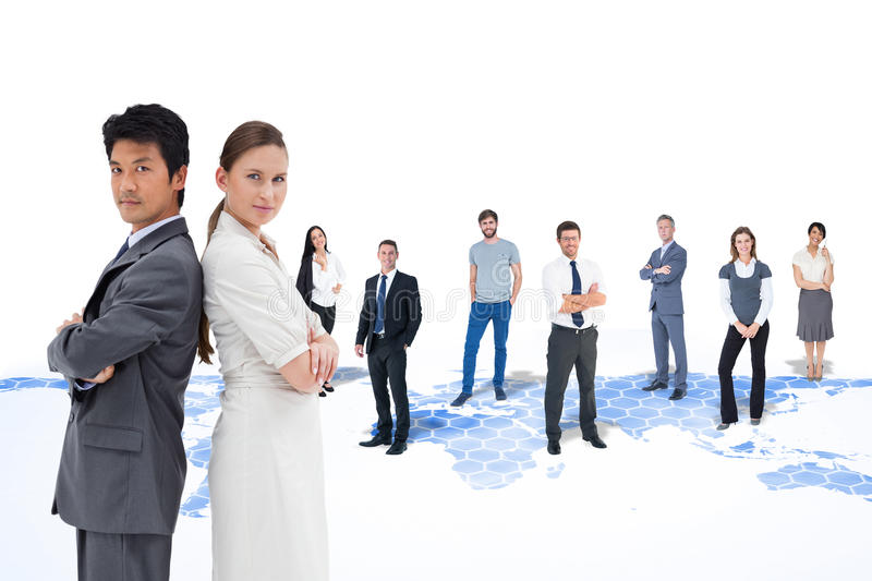 Composite image of portrait of business people standing back-to-back stock image