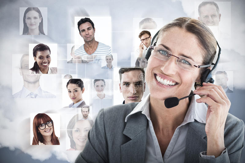 Composite image of portrait of a call center executive wearing headset royalty free stock photo
