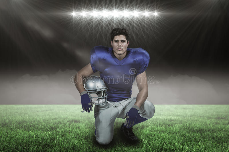Composite image of portrait of confident american football player holding helmet with 3d. Portrait of confident American football player holding helmet against stock images