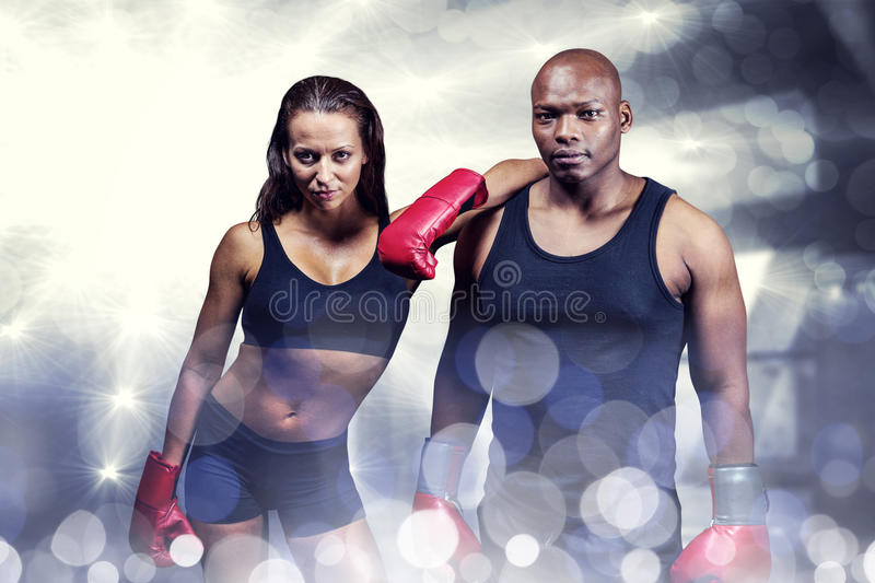 Composite image of portrait of confident boxers stock photography