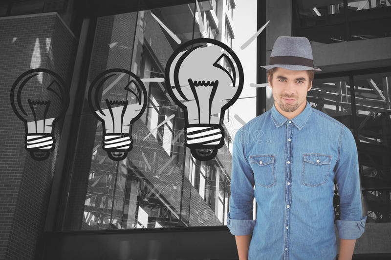 Composite image of portrait of confident hipster wearing hat stock photo
