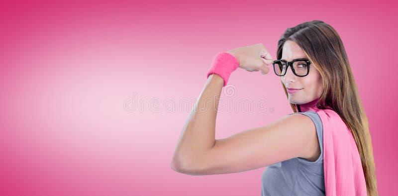 Composite image of portrait of confident woman in superhero costume. Portrait of confident woman in superhero costume against pink vignette royalty free stock photos