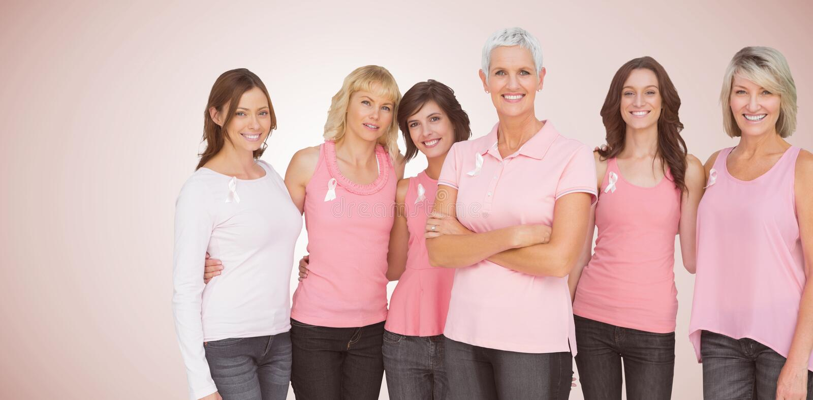Composite image of portrait of confident women supporting breast cancer awareness. Portrait of confident women supporting breast cancer awareness against neutral stock photos