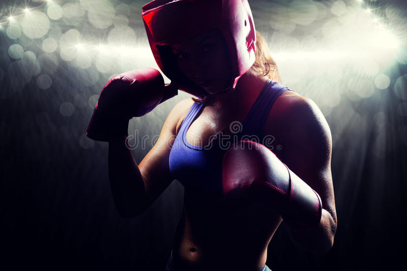 Composite image of portrait of female fighter with fighting stance stock image