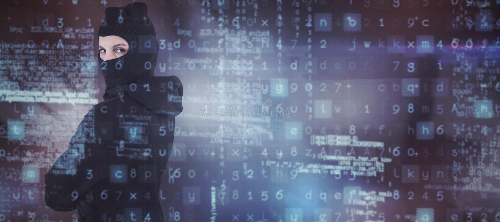 Composite image of portrait of female hacker standing wearing hoodie and balaclava royalty free stock photo