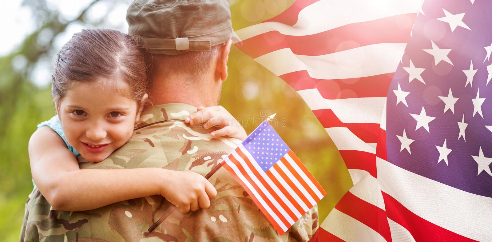 Composite image of portrait of girl hugging army officer father. Portrait of girl hugging army officer father against focus on usa flag royalty free stock image
