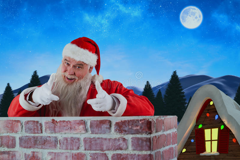 Composite image of portrait of happy santa claus making hand gesture over wall royalty free stock photo