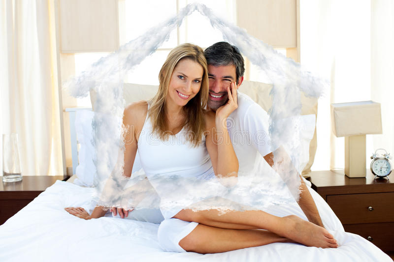 Composite image of portrait of lovers sitting on bed stock images