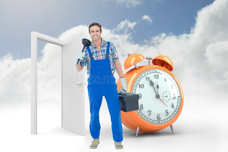 Composite image of portrait of plumber holding plunger and tool box. Portrait of plumber holding plunger and tool box against alarm clock counting down to twelve stock photo