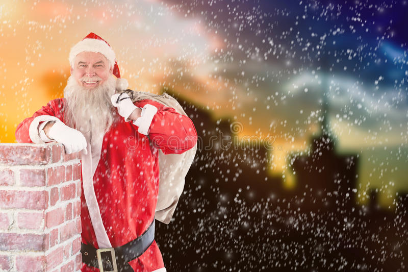 Composite image of portrait of santa claus carrying bag full of gifts royalty free stock photos