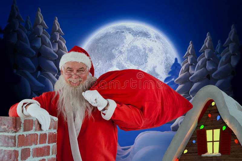 Composite image of portrait of santa claus carrying bag full of gifts royalty free stock photography