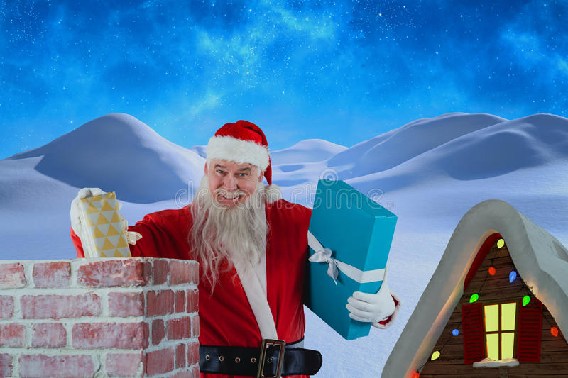 Composite image of portrait of santa claus placing gift boxes into chimney stock photography