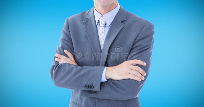Composite image of portrait of smiling businessman standing hands folded royalty free stock photo