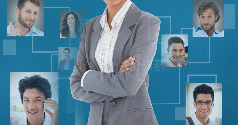 Composite image of portrait of smiling businesswoman standing arms crossed stock photography