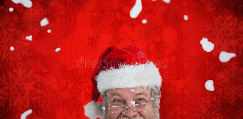 Composite image of portrait of smiling santa claus stock image