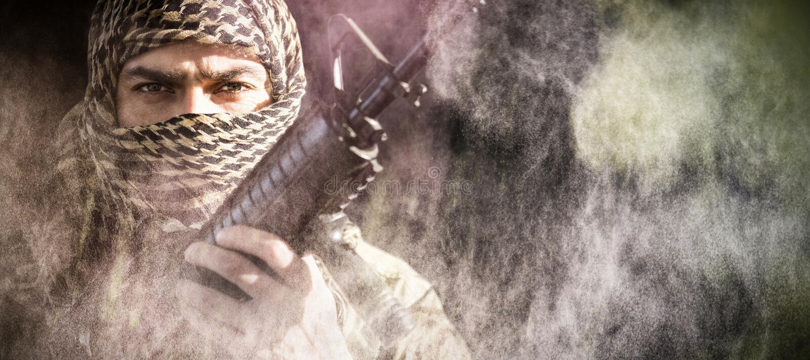 Composite image of portrait of soldier holding a rifle stock photos