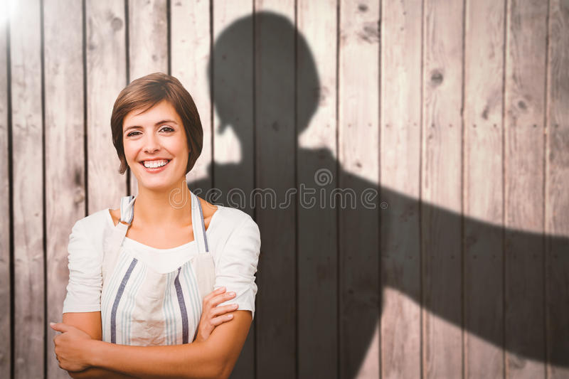 Composite image of portrait of waitress. Portrait of waitress against digitally generated grey wooden planks stock photography