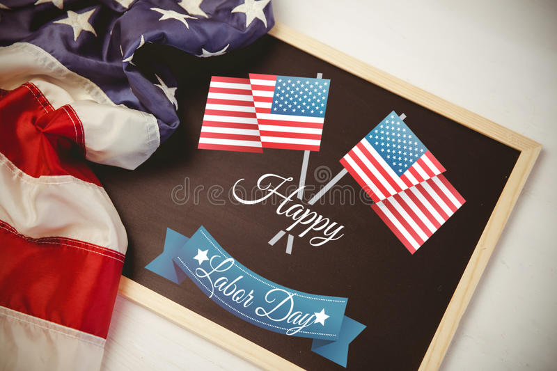 Composite image of poster of happy labor day text. Poster of happy labor day text against american flag on chalkboard stock photos