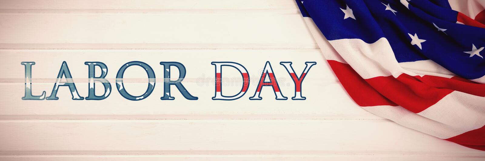 Composite image of poster of labor day text. Poster of labor day text against close-up of an american flag stock illustration