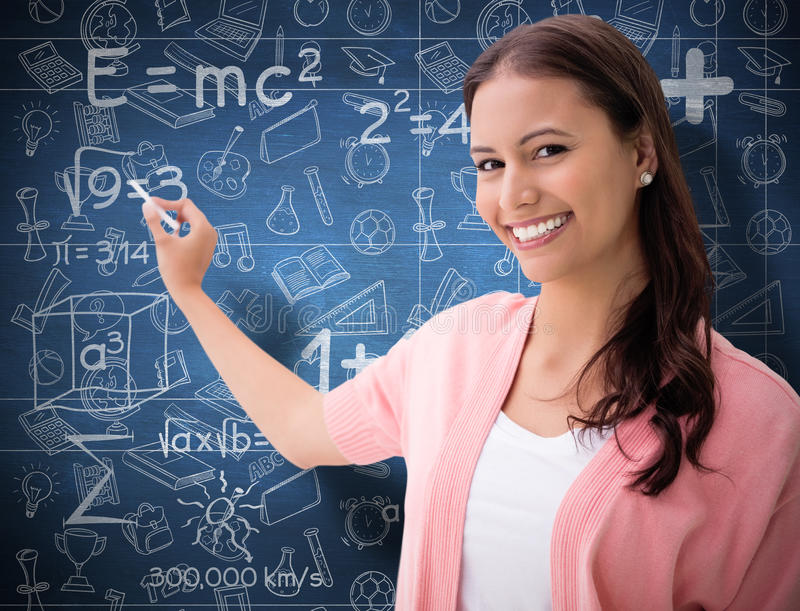 Composite image of pretty brunette smiling and writing stock photo