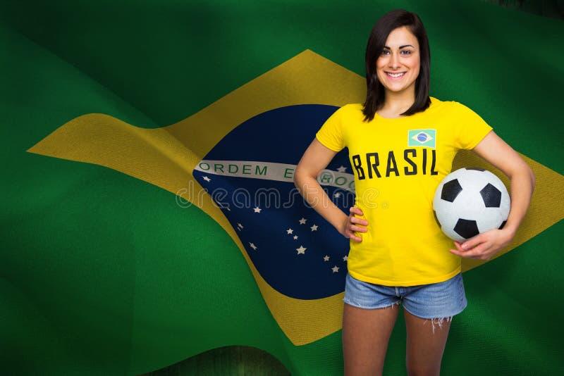 Composite image of pretty football fan in brasil tshirt