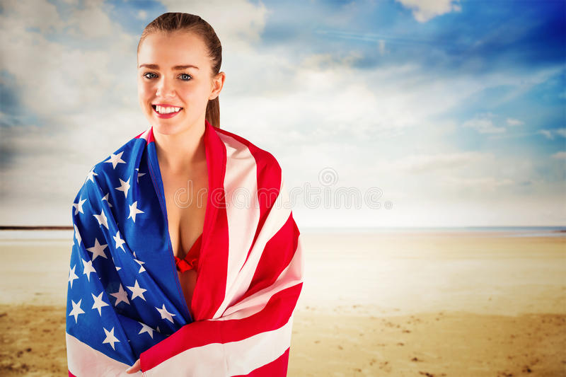 Composite image of pretty girl in bikini with american flag stock images