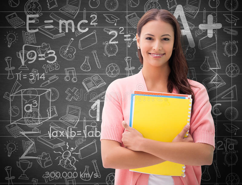 Composite image of pretty student smiling at camera stock photography