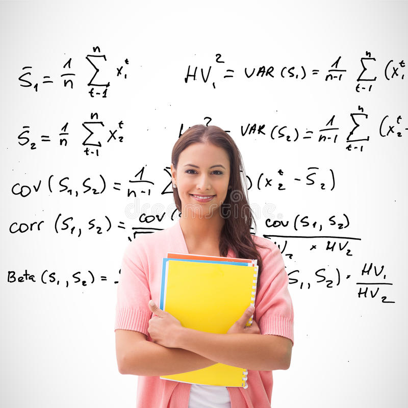 Composite image of pretty student smiling at camera royalty free stock photography