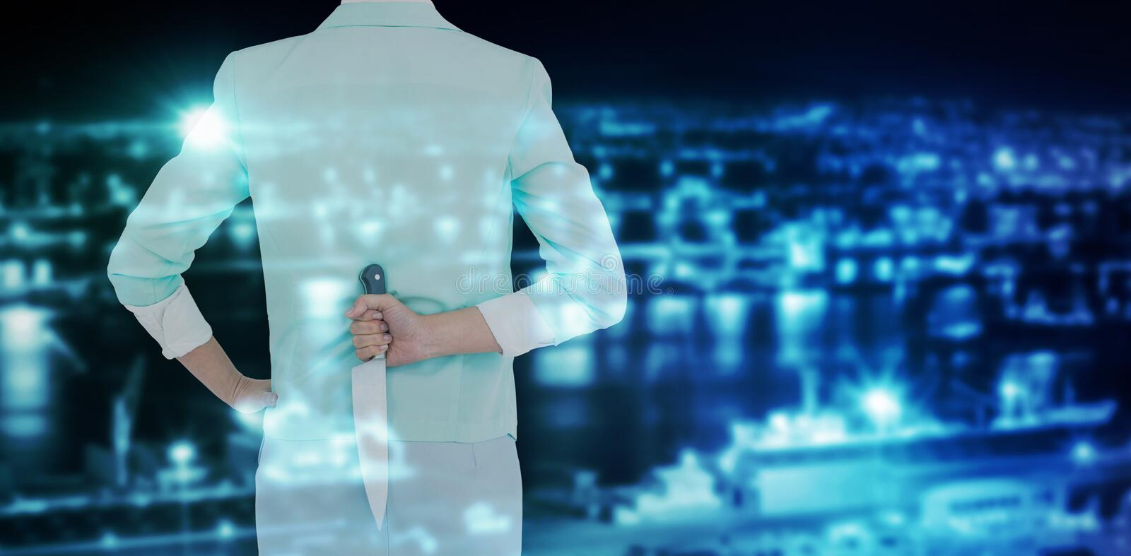 Composite image of rear view of businesswoman hiding knife. Rear view of businesswoman hiding knife against illuminated harbor against cityscape stock images
