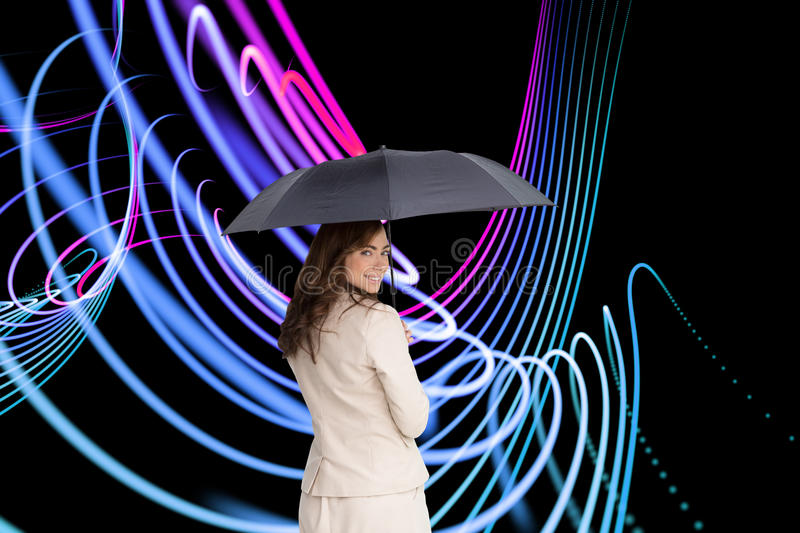 Composite image of rear view of businesswoman holding umbrella. Composite image of rear view of classy businesswoman holding umbrella royalty free stock images