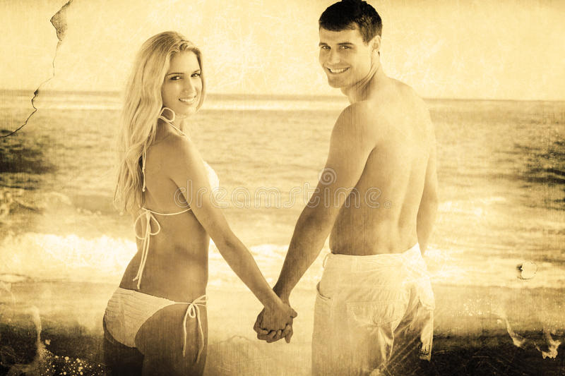 Composite image of rear view of couple holding hands looking stock images
