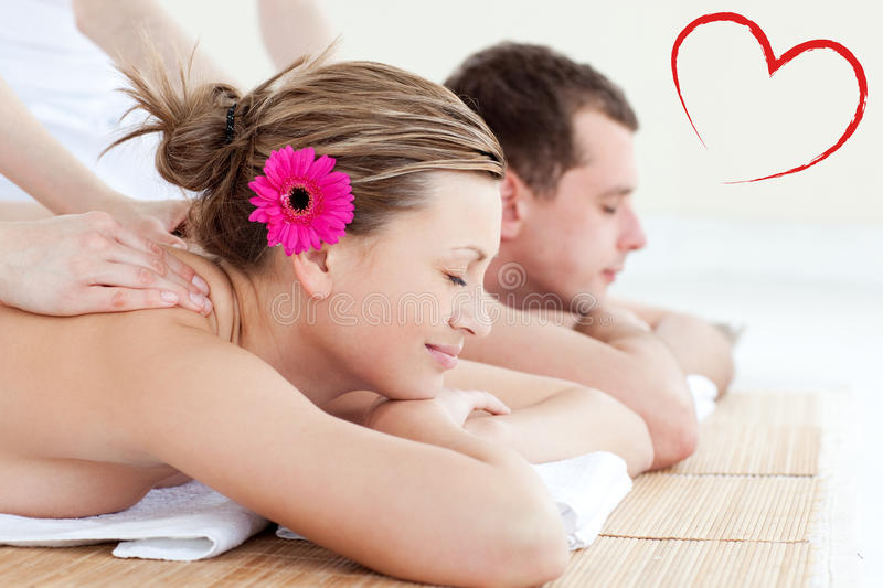 Composite image of relaxed young couple receiving a back massage royalty free illustration