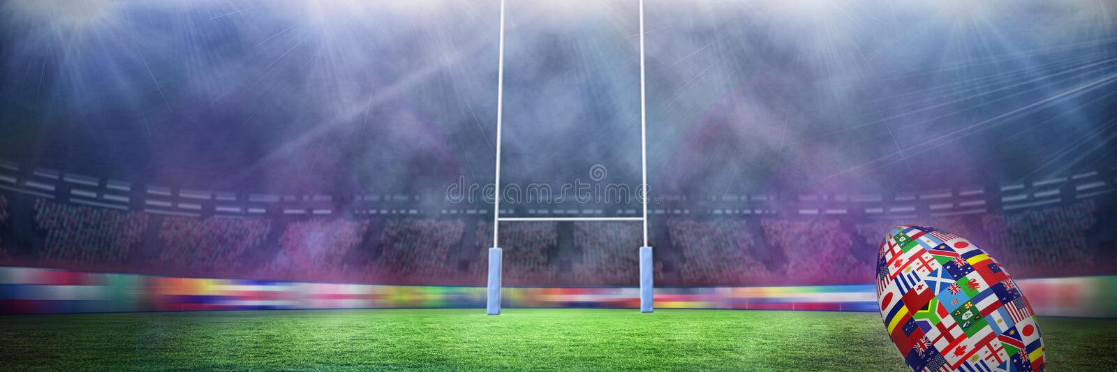 Composite image of rugby world cup international ball. Rugby world cup international ball against rugby pitch stock images