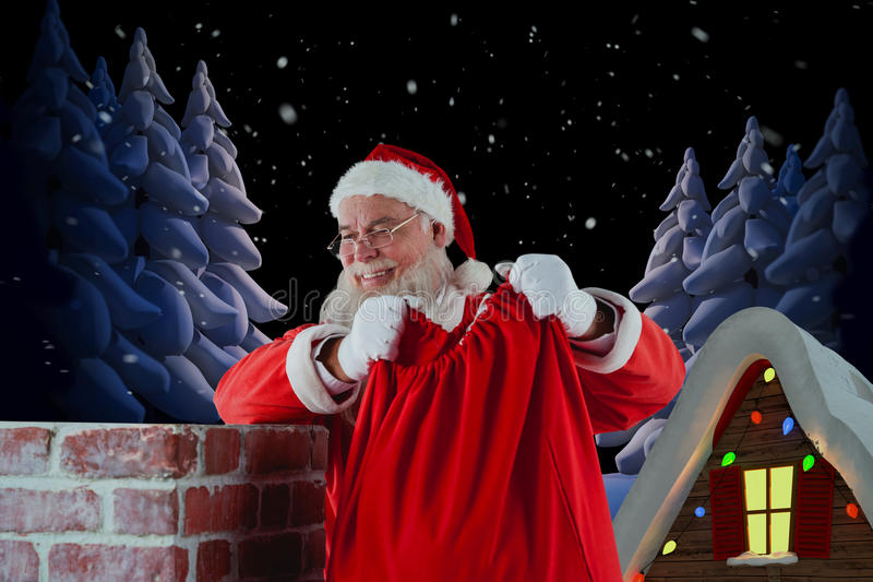 Composite image of santa claus holding gift sack into chimney stock photography