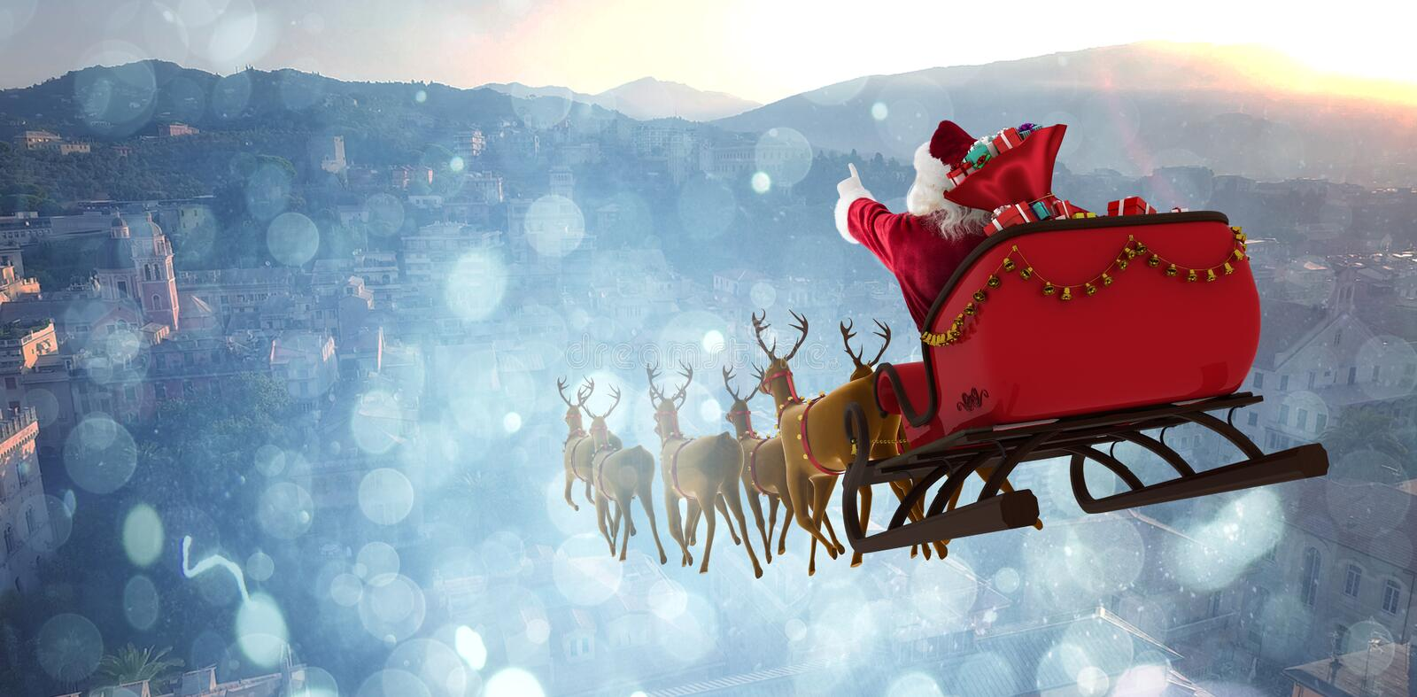 Composite image of santa claus riding on sleigh with gift box royalty free stock images
