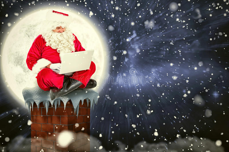 Composite image of santa sitting and using his laptop royalty free illustration