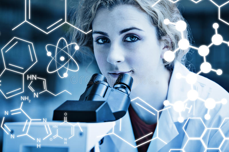 Composite image of science graphic. Science graphic against close up of a young student posing with a microscope stock illustration