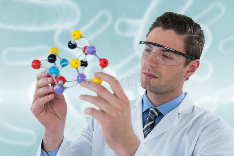 Composite image of scientist experimenting molecule structure 3d stock photos