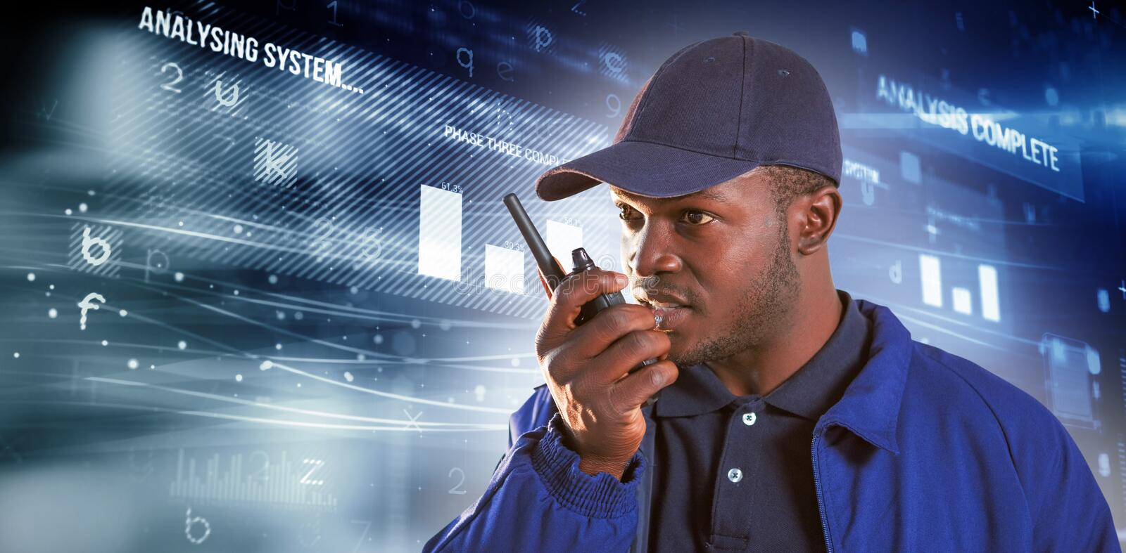 Composite image of security officer talking on walkie talkie. Security officer talking on walkie talkie against virus background royalty free stock images