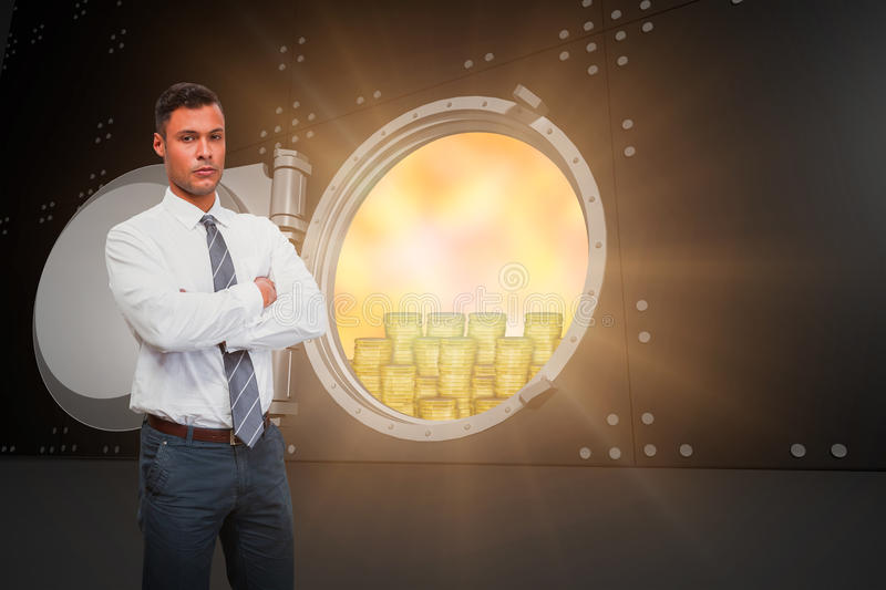 Composite image of serious manager with arms crossed in warehouse stock photos