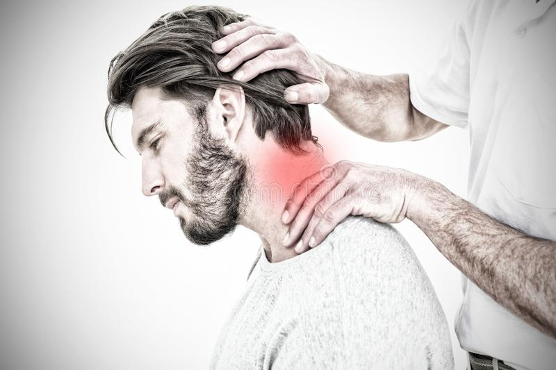 Composite image of side view of a man getting the neck adjustment done. Side view of a man getting the neck adjustment done against highlighted pain stock images