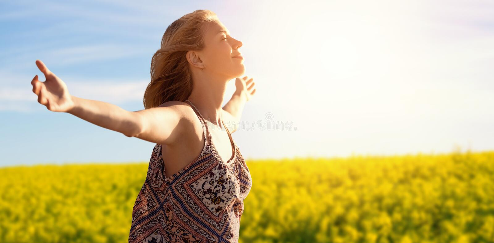 Composite image of side view of a woman raising arms up stock photo