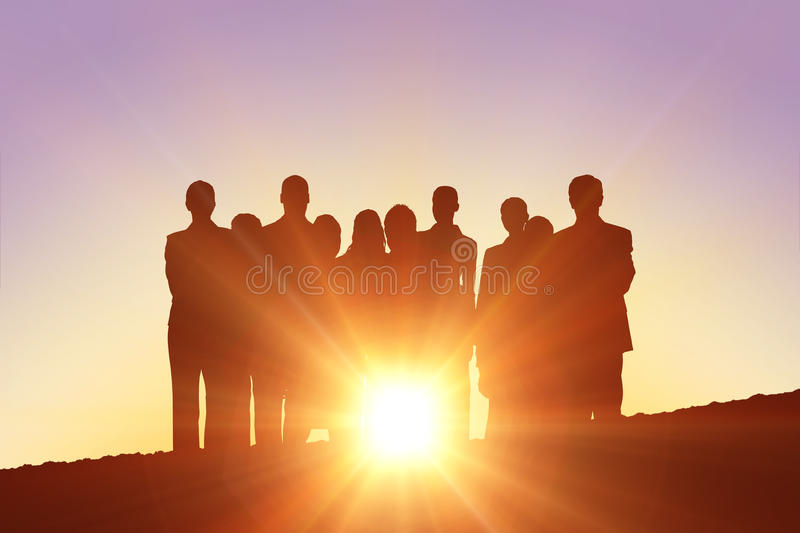 Composite image of silhouettes standing. Silhouettes standing against a sun set royalty free stock photography