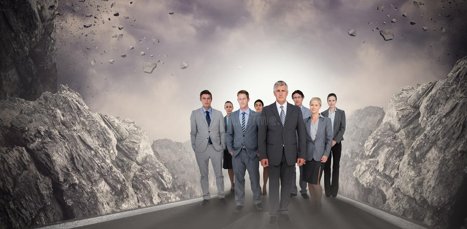 Composite image of smiling business team looking at camera royalty free stock photos