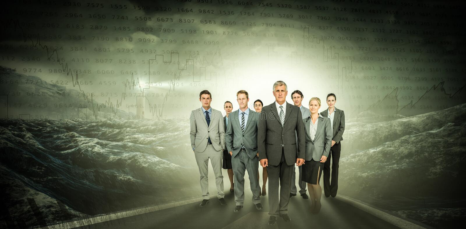 Composite image of smiling business team looking at camera stock image